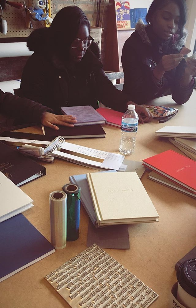 Image:  TRACE Teens working on book design at Candor Arts.