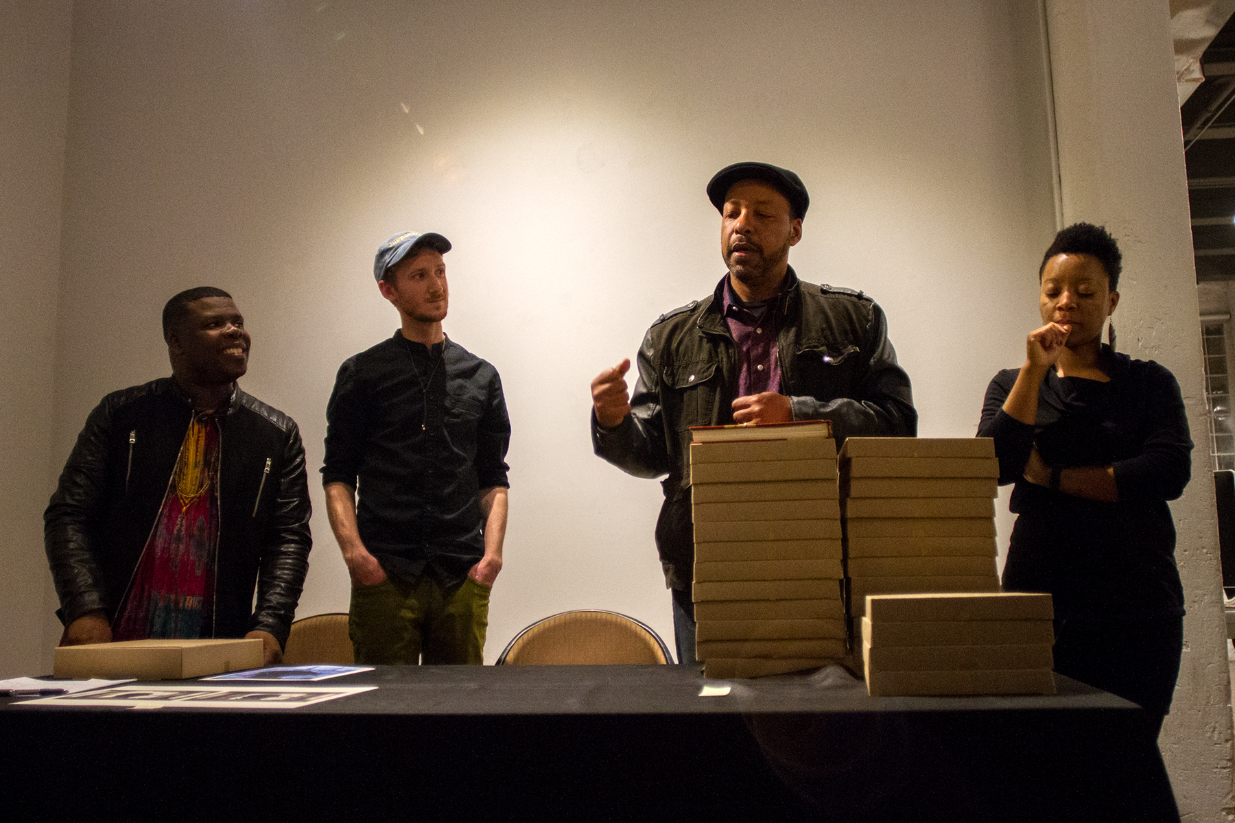 Cecil McDonald, Jr. speaking beside collaborators avery r. young (far left) and Tempestt Hazel (far right) for the release of   In the Company of Black     hosted at Filter Photo.