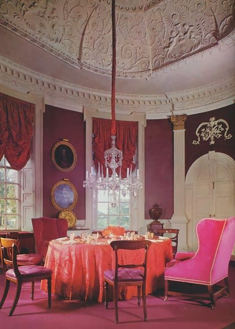 "David Hicks' design for the oval dining room at Britwell Salome, which he called, ""A play on reds."""