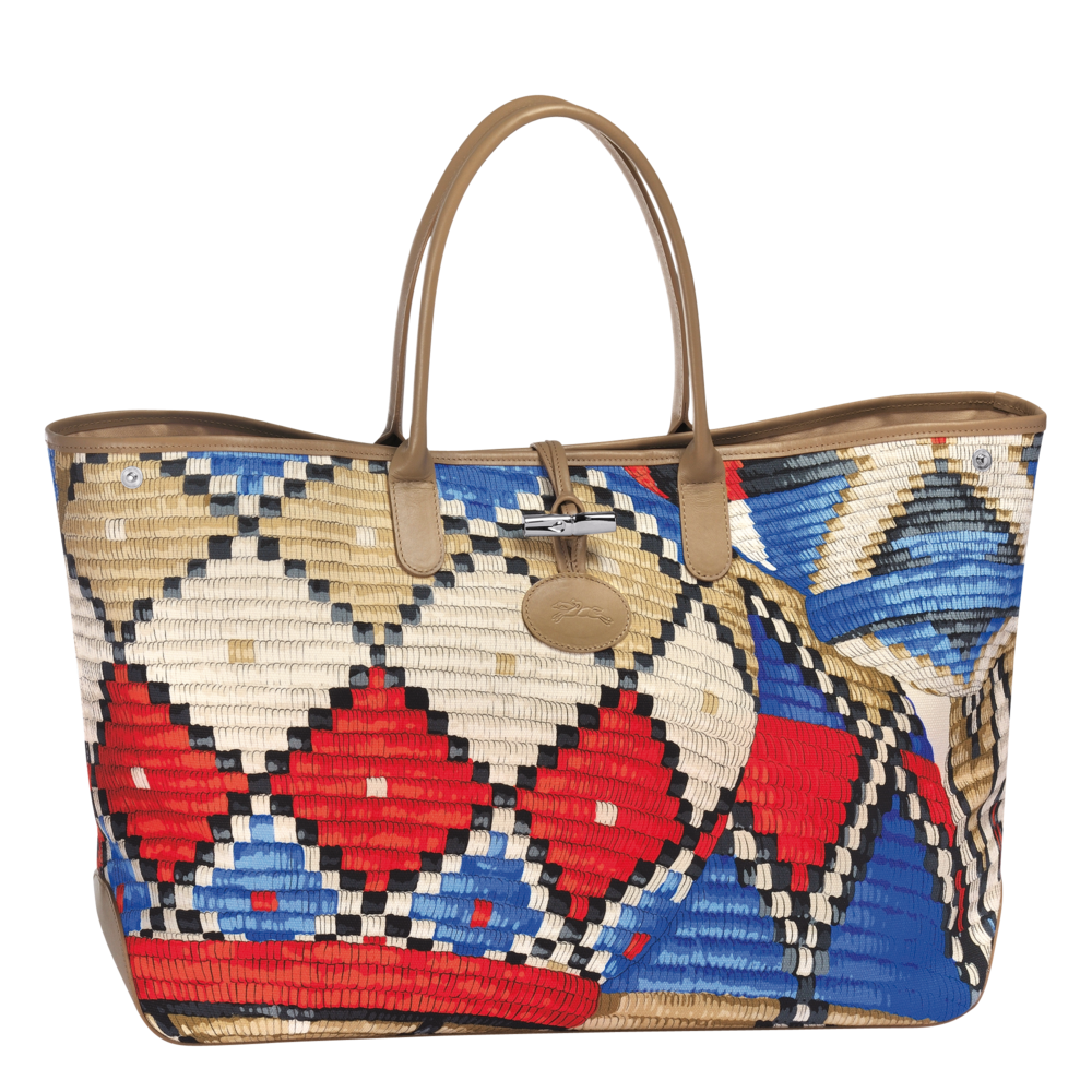 The ROSEAU by LONGCHAMP is inspired by the skillful basket-weaving of Africa.