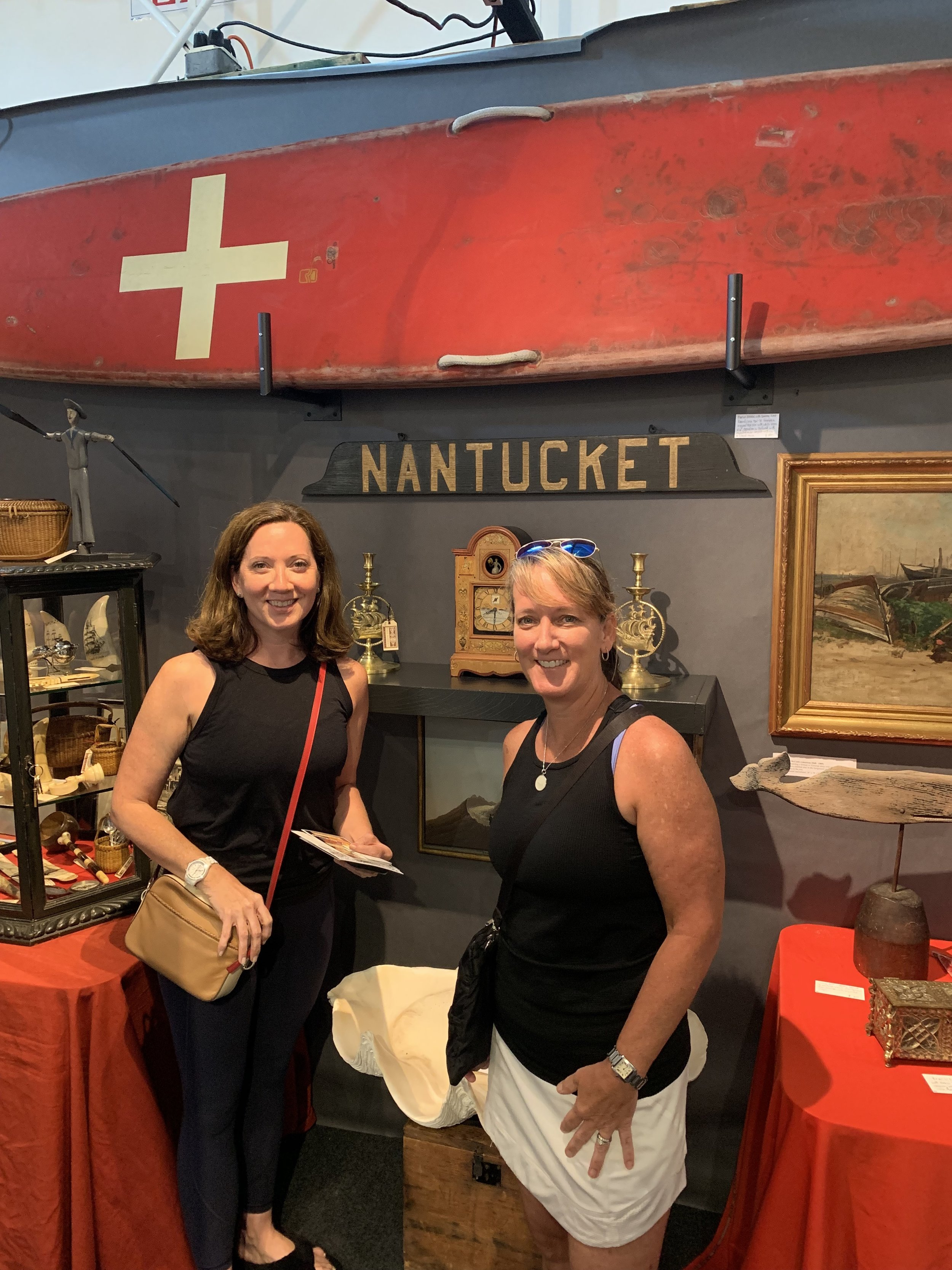 {Laura and I at the antiques show. She purchased this Nantucket sign for her new kitchen}