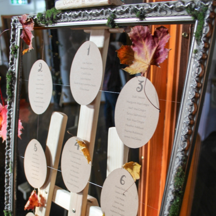 Floating Leaf Table Plan - A table plan is usually the first thing a guest sees so why not make a statement with it. Think about adding depth with floating elements, texture with brown card and natural elements such as moss and leaves to create something both useful but impressive for your entrance.