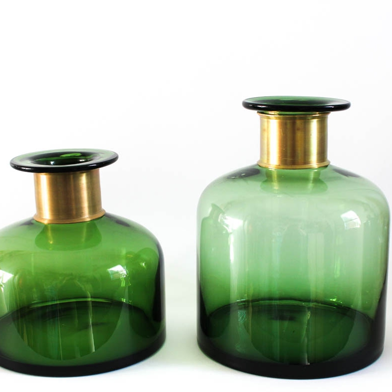 Glass vases - The more handblown and irregular the better. Keep to natural colours or clear to add more greenery to your tables.
