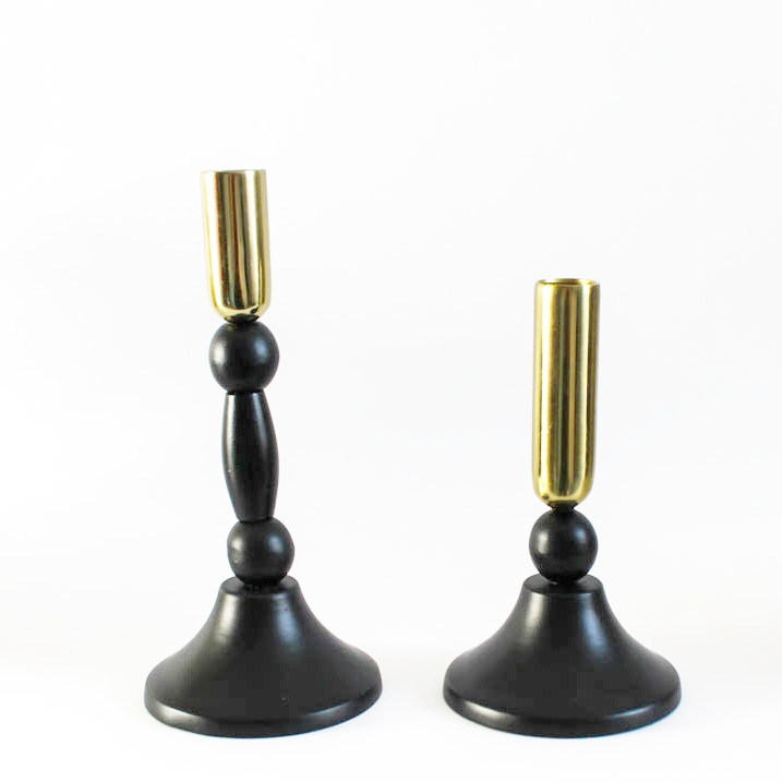Black and Gold Candlesticks - Some people can be frightened by black, but paired with gold this adds a luxe touch to the rougher materials of an industrial space. The candles are great when the night draws in too.
