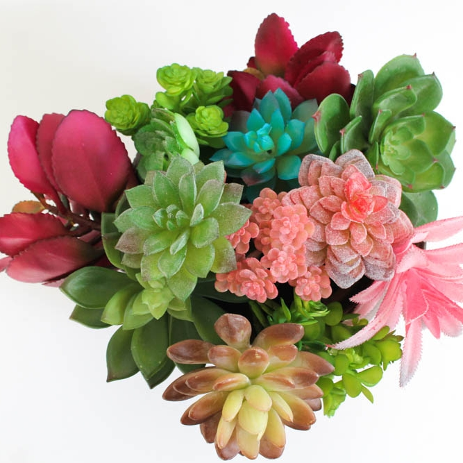 Succulents - A great alternative to flowers, keep them green and natural or think about more vibrant varieties to add a pop of colour.