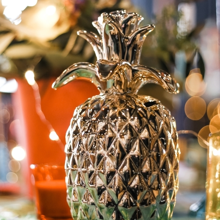 Golden Pineapple - Adding just a hint of tropical and gold to tie everything together will help that touch of fun and sophistication to your table display.