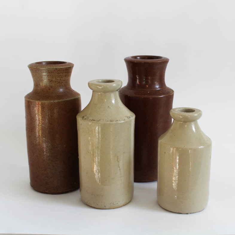 Glass and earthenware bottles - Green bottles and earthen ware pots make great vessels for flowers and greenery. Use these on window sills, tables or anywhere else you can think off to create hight and interest to your space. Add some additional greenery and some all important fairy lights to really emphasise these lovely antique elements.