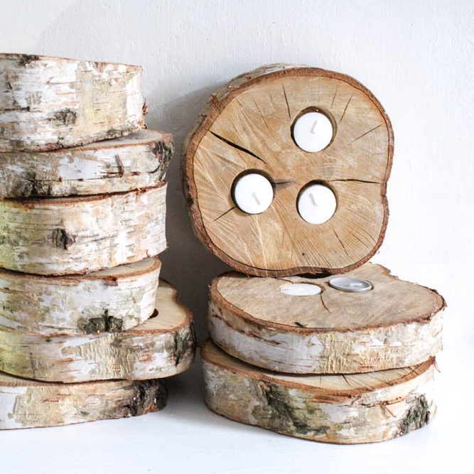 Log Slice Tea Light Holders - Great for part of a table centre or dotted around the venue, these tea light holders are a nice addition to add some candle light to your venue.