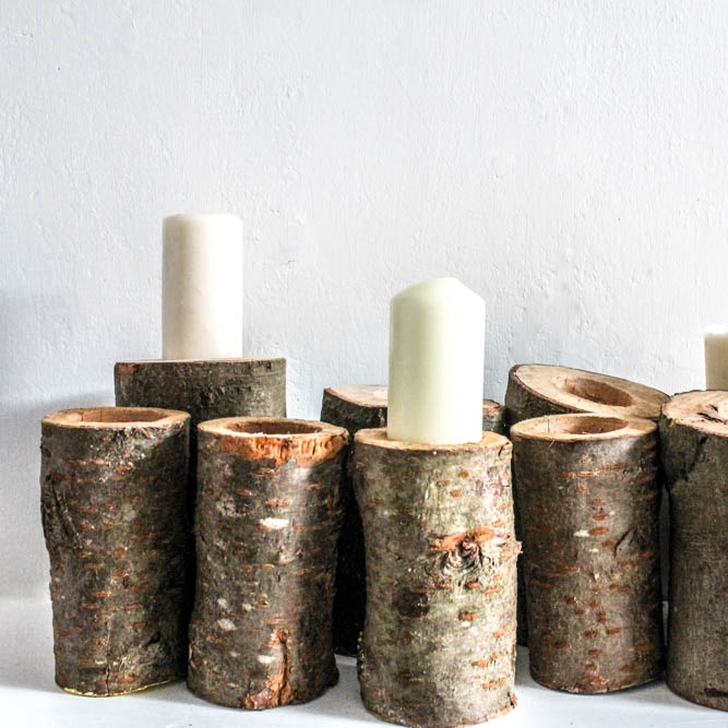 Log Candle Holder - Great for part of a table centre or dotted around the venue, these rustic candle holders are a nice addition to add some candle light to your venue.