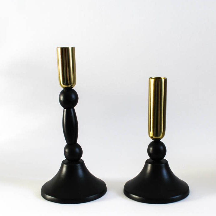 Black and Gold Candlesticks - Great as part of a centrepiece, on a mantlepiece of a fireplace or window sill. The candle light will add just the right atmosphere.