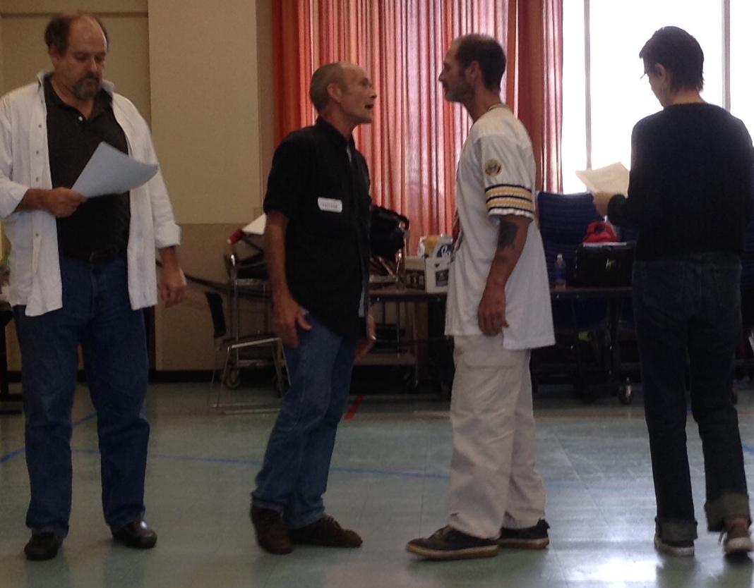 John M. Buck (left) works a scene with FoC staff.
