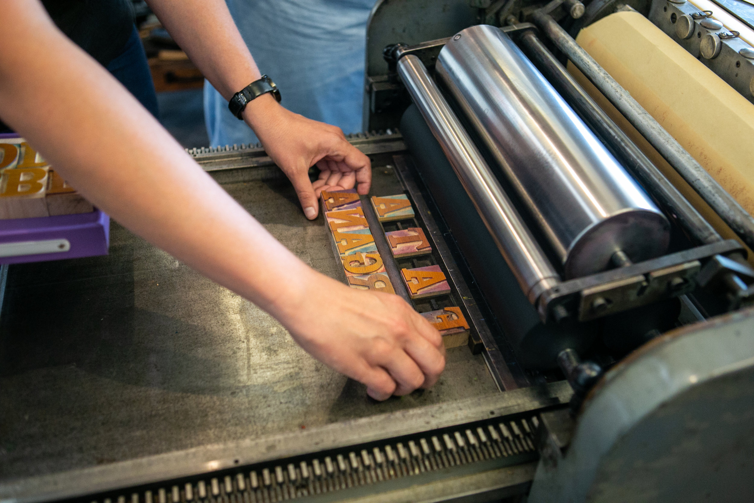 Wood and Metal type on press