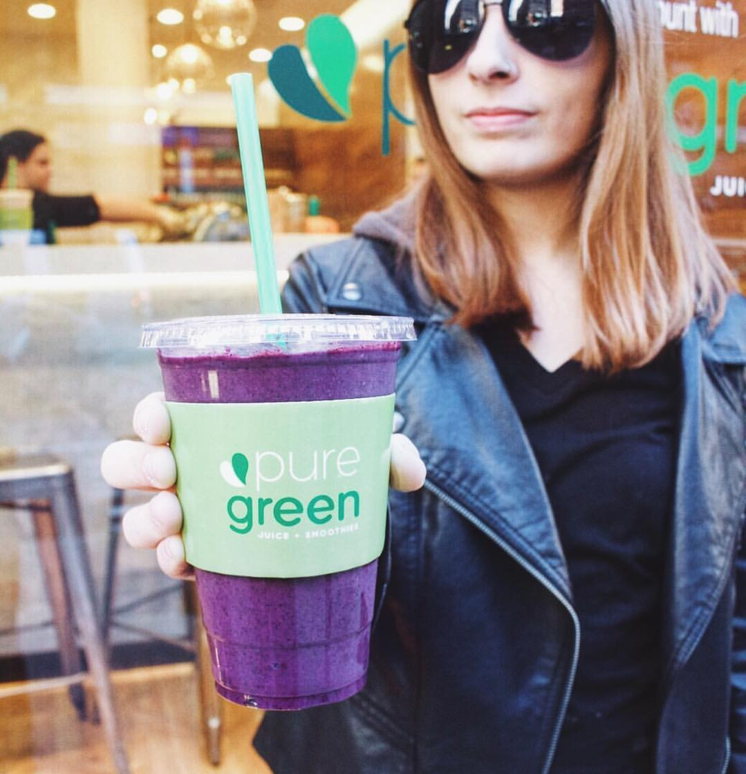 Girl Holding Purple Pure Green Smoothie