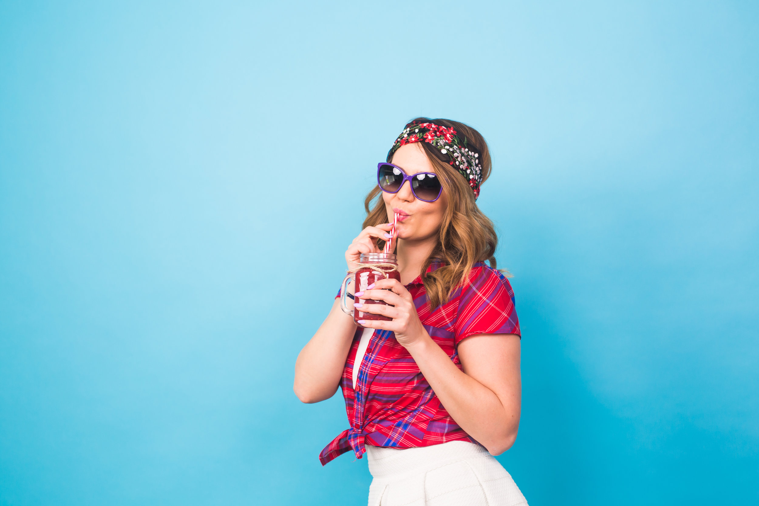 young-sexy-hipster-woman-drinking-tasty-smoothie-PWCYXDL.jpg