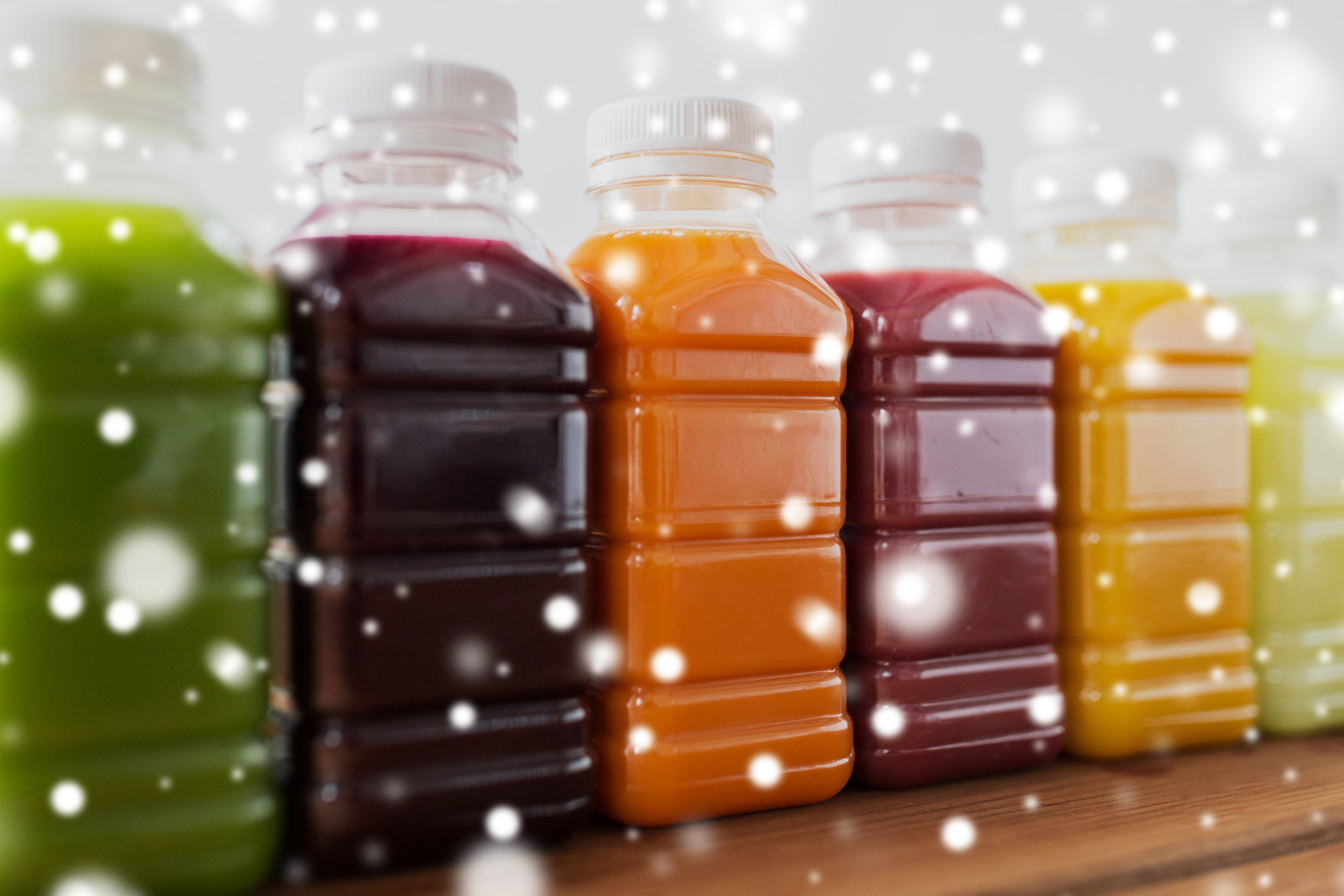 bottles-with-different-fruit-or-vegetable-juices-PY4XABX.jpg