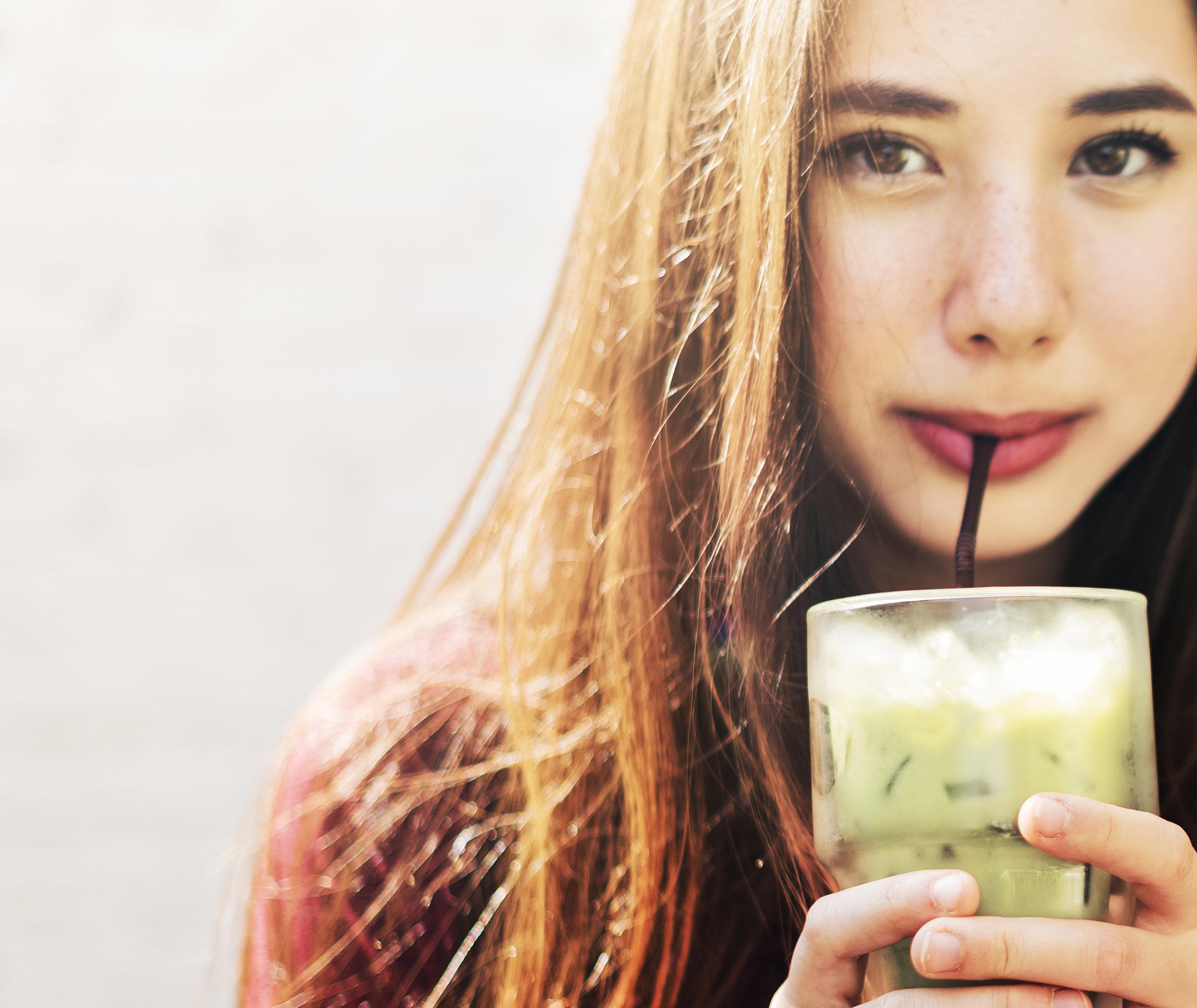 woman-refreshing-herself-with-green-tea-PB92654.jpg