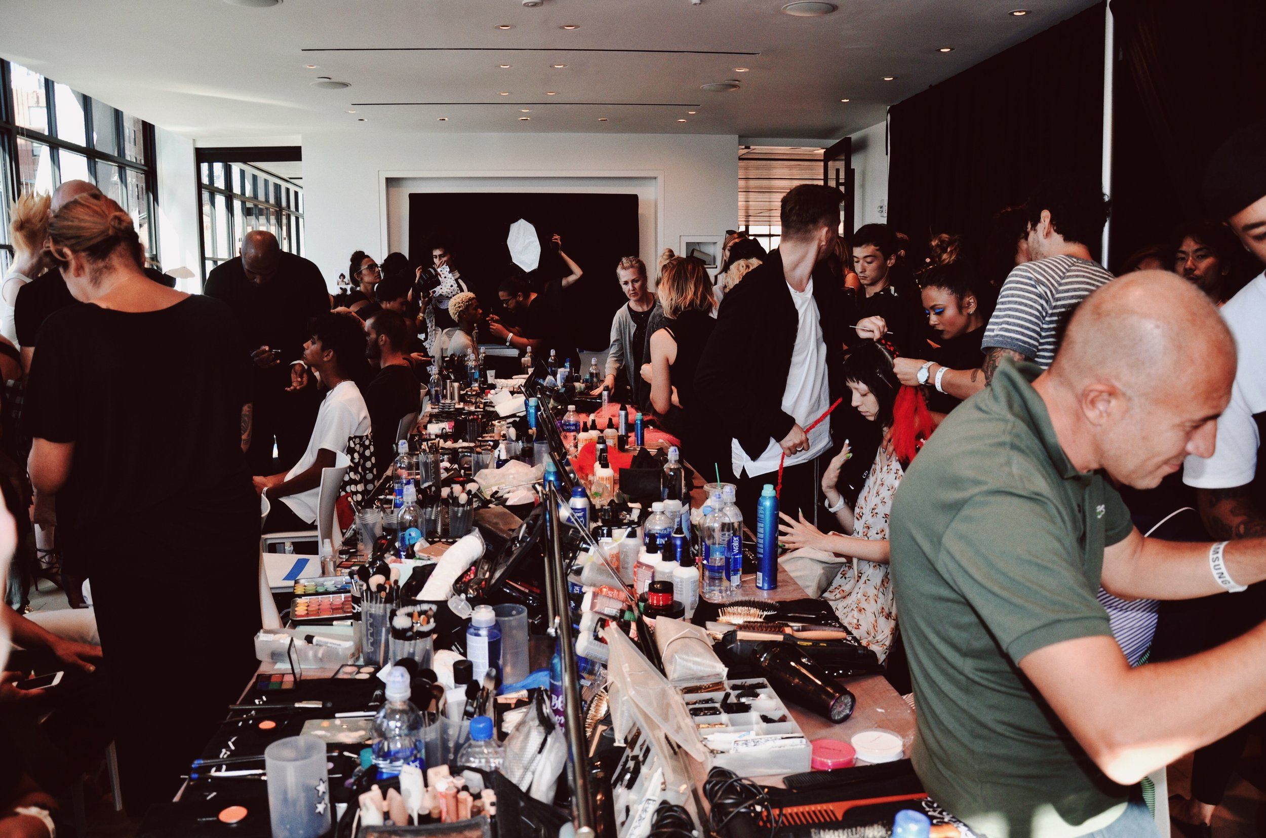 A backstage look at the Gypsy Sport glam team.
