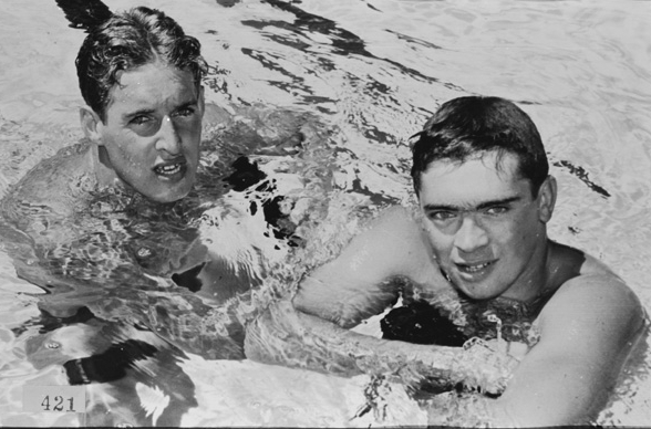 Kevin Berry (left) after setting a new Games Record in 220 yd butterfly. (Supplied: State Library of Western Australia)