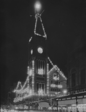 Perth Town Hall illuminated at night for the celebrations. (Supplied: State Library of Western Australia)