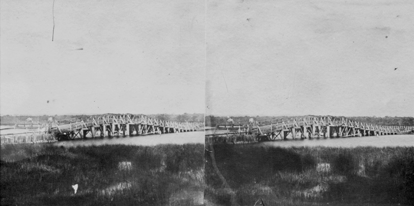 Between 1837 and 1838, preliminary works were completed before construction fully began;these included paving Adelaide Terrace up to the riverfront. The first Causeway commenced construction on 2 November 1840 with pile driving for the foundations taking place. The bridge itself was completed a year later in 1841 with the surrounding approaches being finished throughout 1842. The Causeway was officially opened by Chairman of the Road Trust J. W. Hardey on 24 May 1843.  The bridge was originally a toll road with 6d being charged to horse and carriage riders, and 1d for pedestrians on foot to cross. The original Causeway remained the only Swan River crossing in Perth for 19 years until it was largely destroyed during flooding in the winter of 1862. Pictured above, the first Causeway in 1862, prior to its destruction later that same year. (Supplied: State Library of Western Australia)