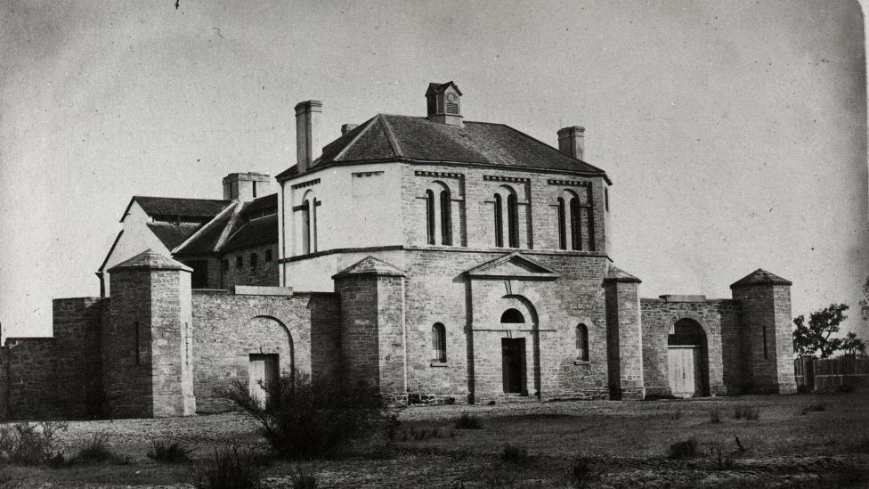 The proposal for the gaol was approved by WA Charles Governor Fitzgerald in December of 1853, with construction to begin the next year. The location, at the intersection of Beauford and Francis Streets, was chosen for its proximity to the centre of Perth. Designed by colonial architect Richard Roach Jewell, the two story structure was built using convict labour and used limestone sourced from Fremantle. The gaol contained a basement, chapel, gaoler's quarters, cells, and a prisoners' yard, in which executions would take place. Prisoners would be executed here throughout the buildings life as a prison. Pictured, Perth Gaol in 1860, four years after construction was complete and the first prisoners were transferred here. (Supplied: Western Australian Museum)