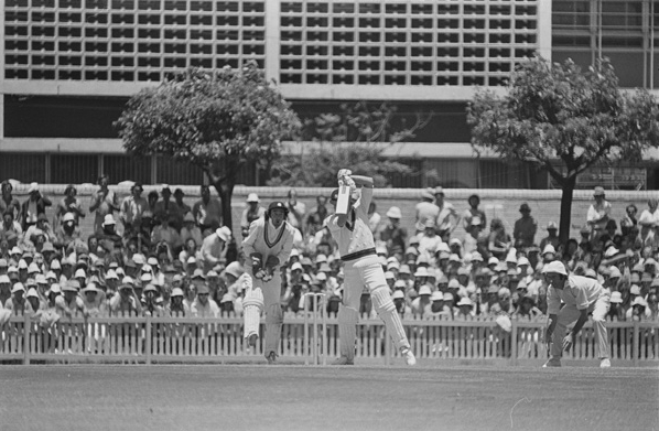 Test cricket had first began at the WACA between 21-24 March 1958 between the English and Australian womens' teams. After this, Players Pavilion was built to provide facilities for the players and the WACA administration, with extra seating being added as well. Construction of the Inverarity Stand, named for South and Western Australian player John Inverarity, was completed in 1970 to coincide with the first International men's test cricket was first held here between 11-16 December 1970, also between Australia and England. Pictured, 2nd Test at the WACA between Australia and England, 14 December 1974. (Supplied: State Library of Western Australia)
