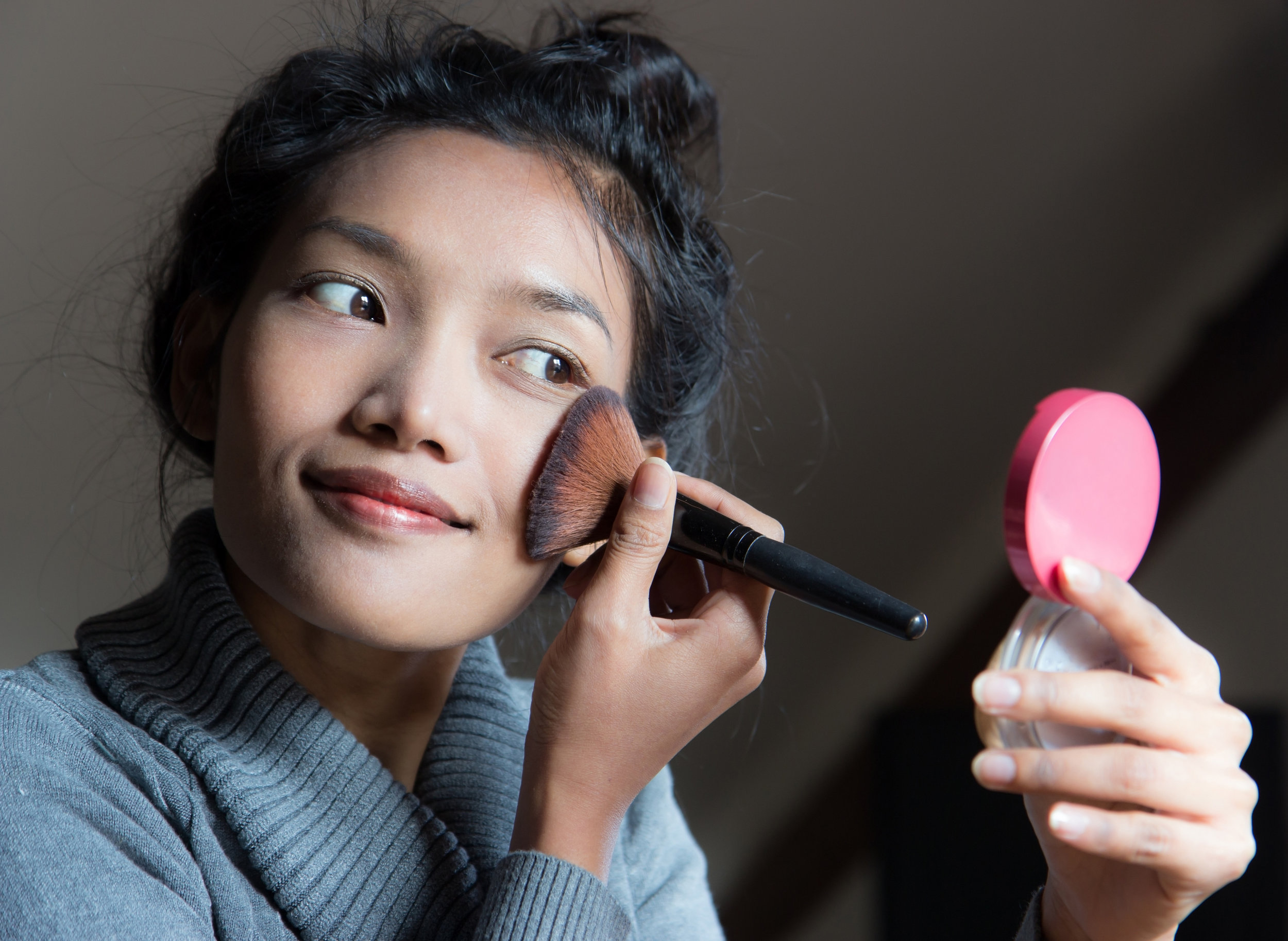 Asian Woman Applying Makeup