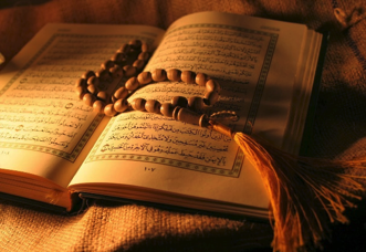 Photo: Open Quran with prayer beads on page