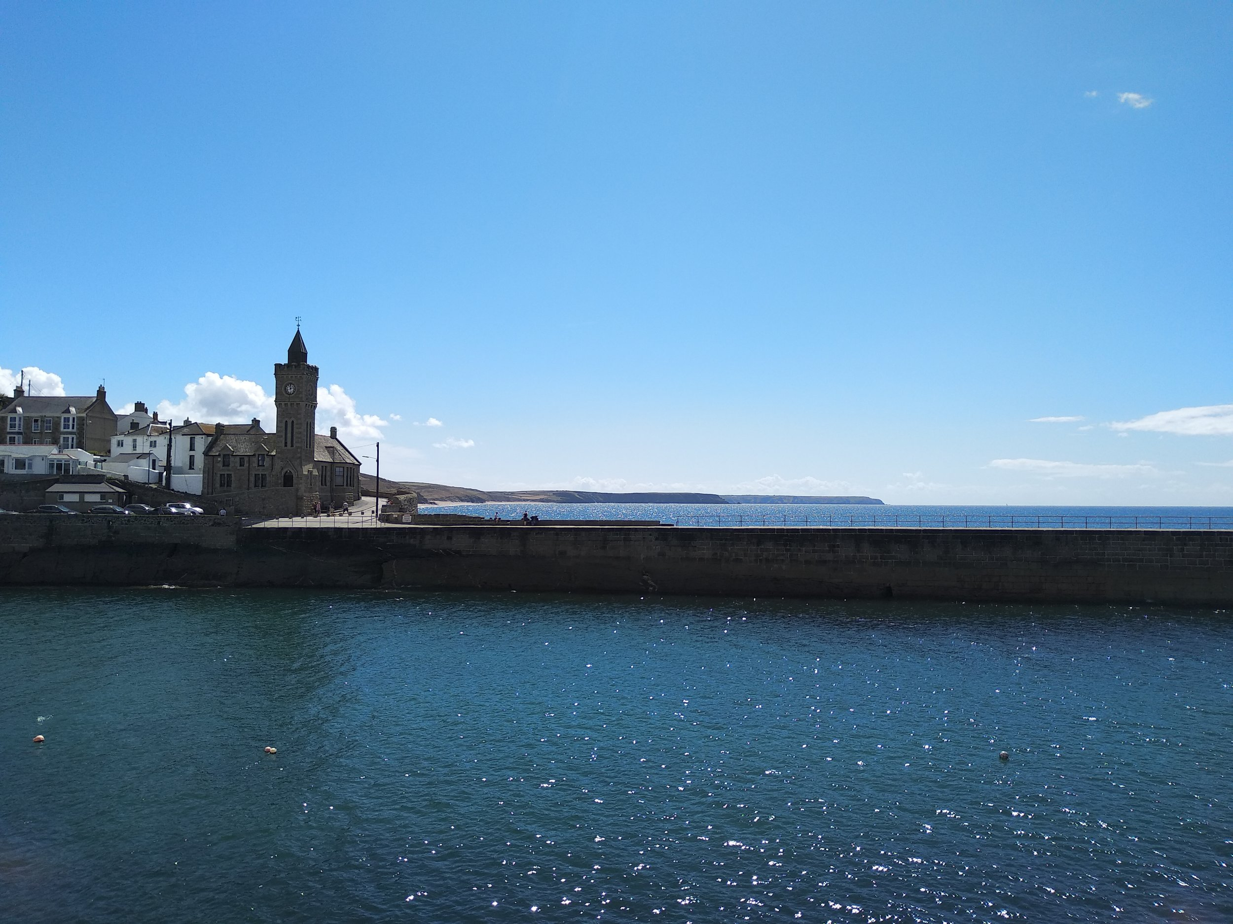 The pier at Porthleven, frequently closed off due to risk of death or injury during storms. Waves are known to reach as far as the Bickford-Smith Institute, hence the BBC background.