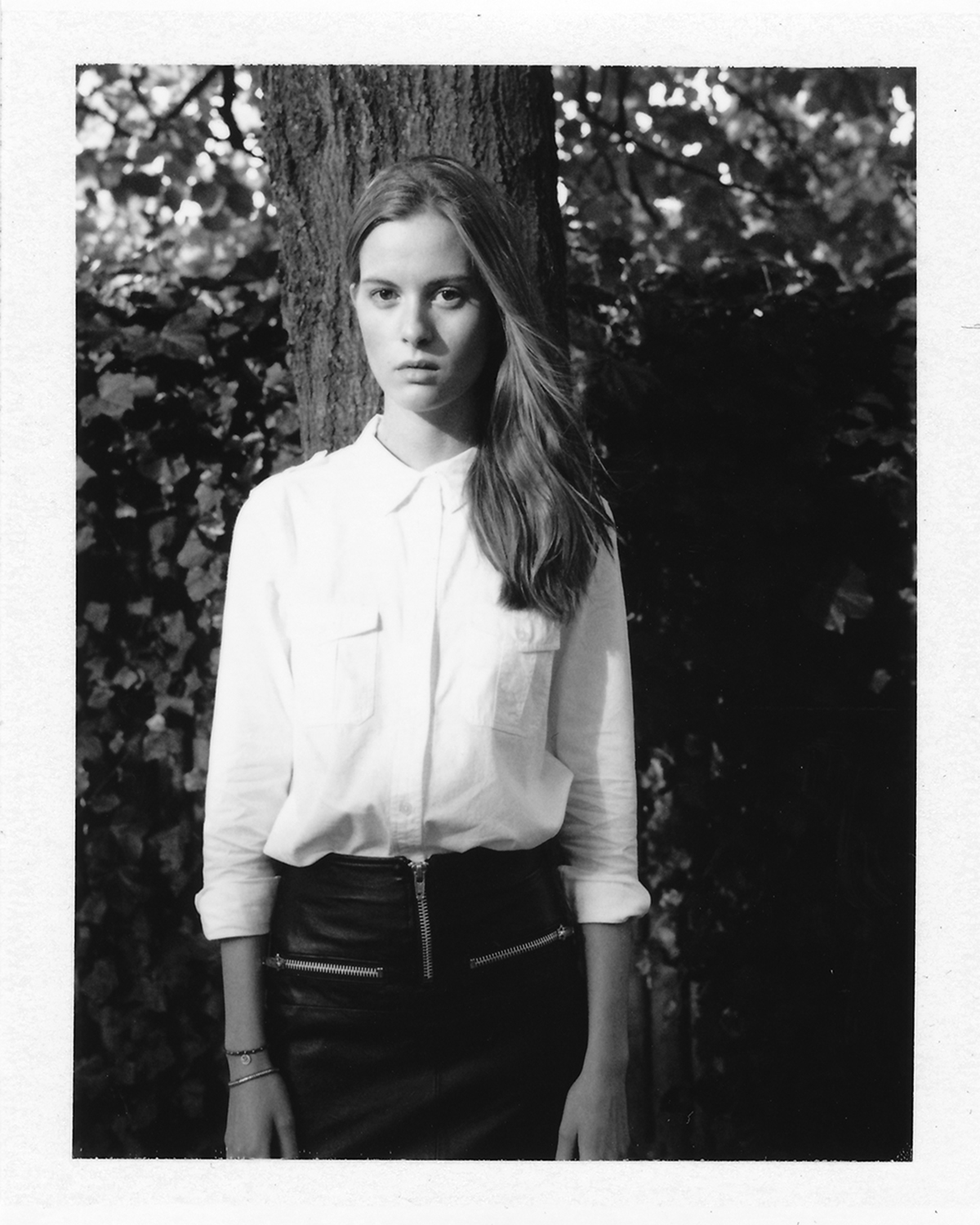 Kim modelling an upcycled leather skirt from  Pelechecoco  & a crisp white shirt from  Skall Studio , all from  My Fair Shop . Photographed by  Mikkel Vigholt  with equipment borrowed from  One of Many Cameras .