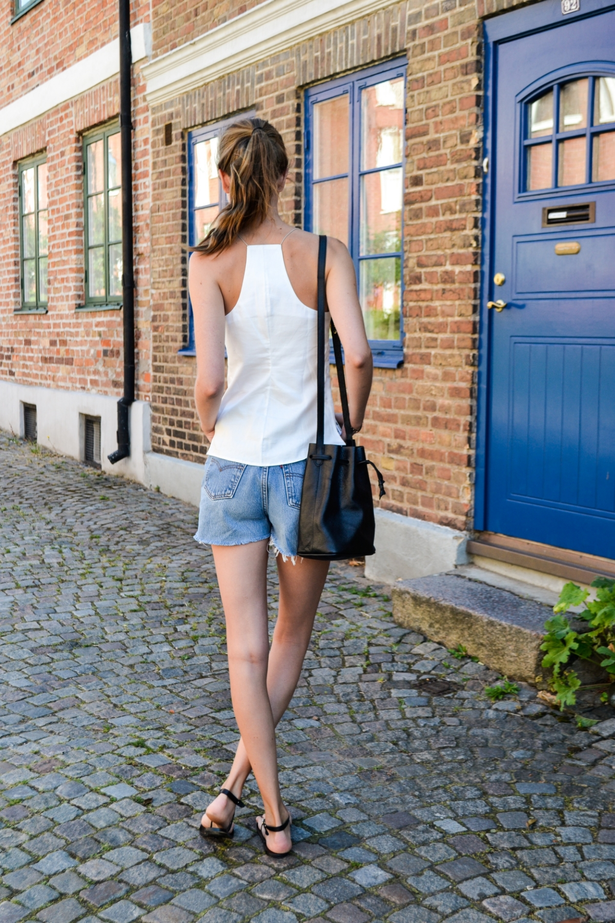 Kim models the Veryan  #009 cami top , second hand Levi's &  ATP Atelier sandals  with her Apapa bucket bag from  Moyi Moyi .