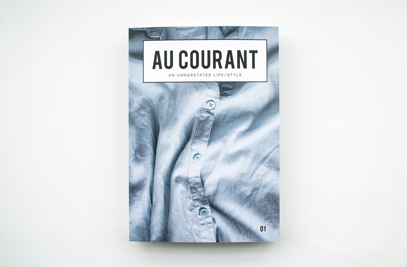 The cover of  Au Courant Volume 01 —a close-up shot of a crumpled shirt, an understated image synonymous with Lisa-Marie's vision.