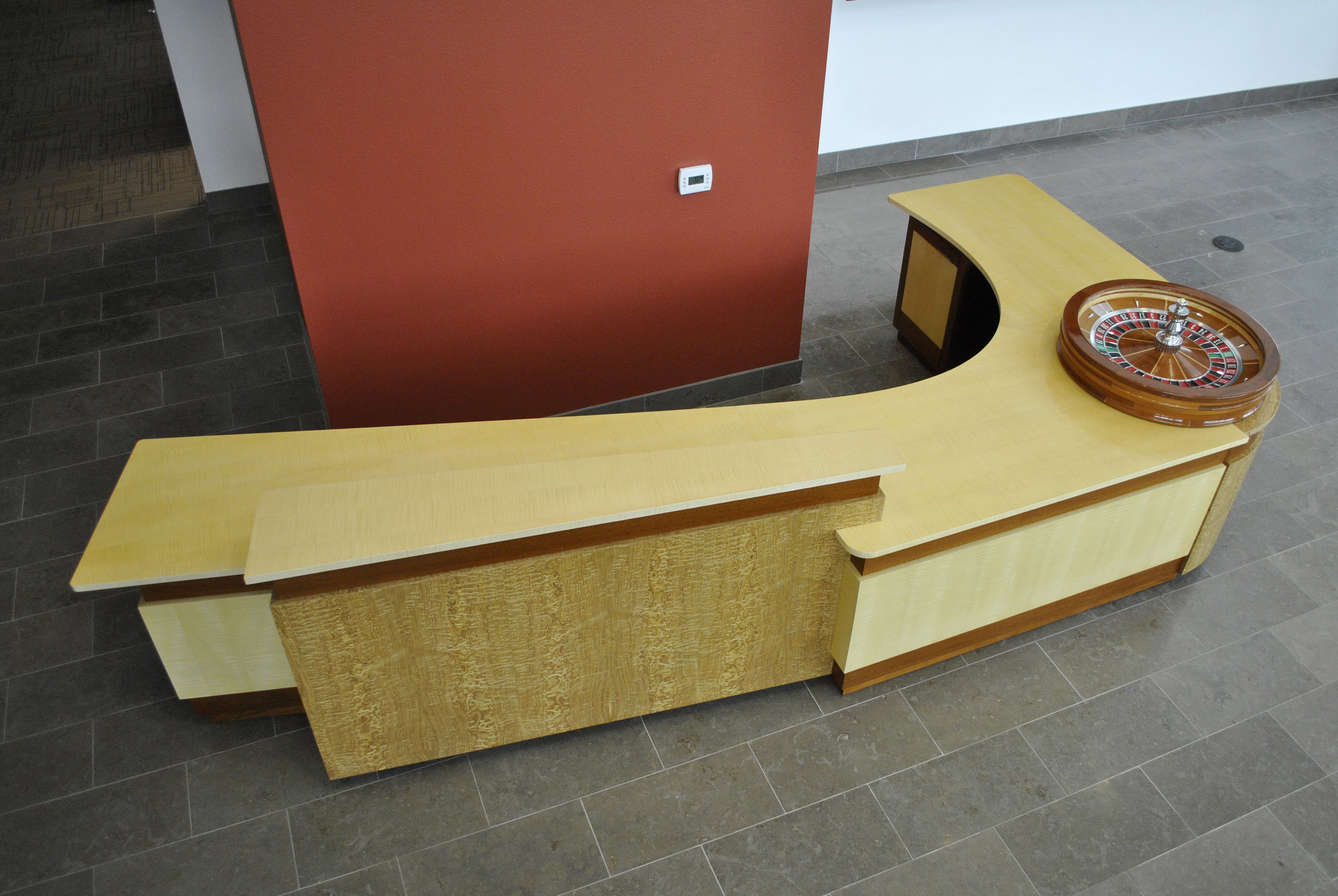 Reception Desks - Reception Desks exist on the line between millwork and furniture. They're always custom and present their own challenges for durability, usability, and wire-management access. Commercial lobby renovations are a common theme on the market today and these small, yet finish heavy projects almost always involve a Reception Desk. We can help! For more information Click!