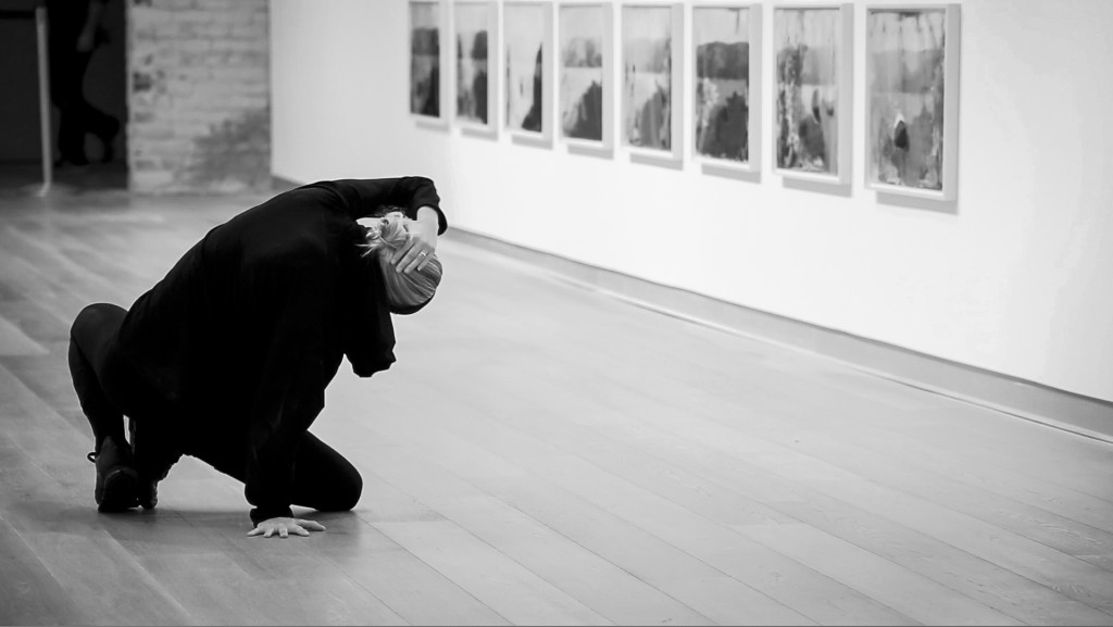 Lilja Rúriksdóttir, one of the performers, making her way across the gallery in smooth, measured movements.