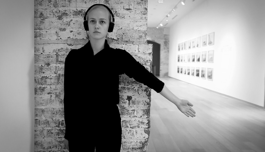 Lilja stopping at one of the original brick archways in the SCAD Museum of Art. The dancers would observe the brick through touch, running their fingers and bodies along each arch.
