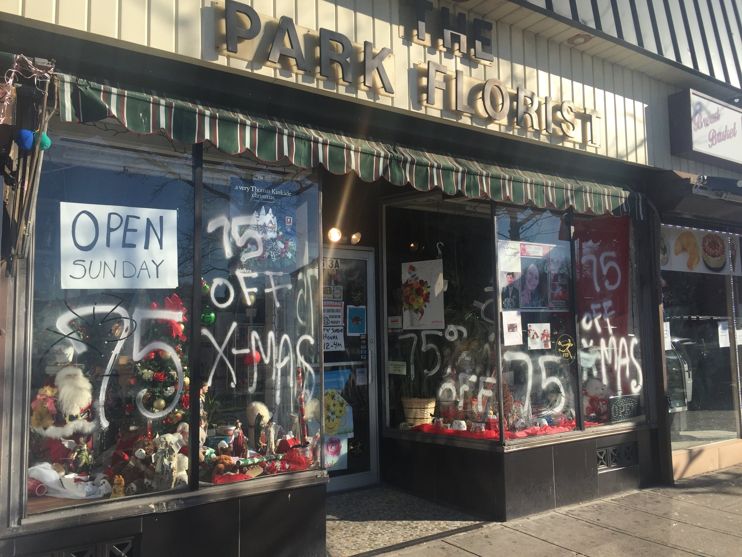 The Park Florist, Park Avenue, Plainfield  has an attractive wall sign, a traditional retractable awning and a well decorated display.
