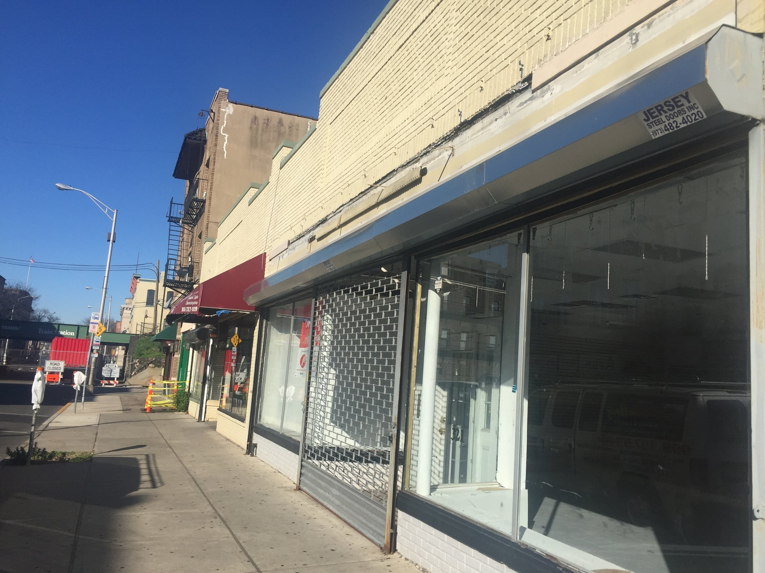 Remove the metal grills!  Metal grilles over the windows and doors of your storefront detracts from its attractiveness and can make an area appear dangerous and unappealing.