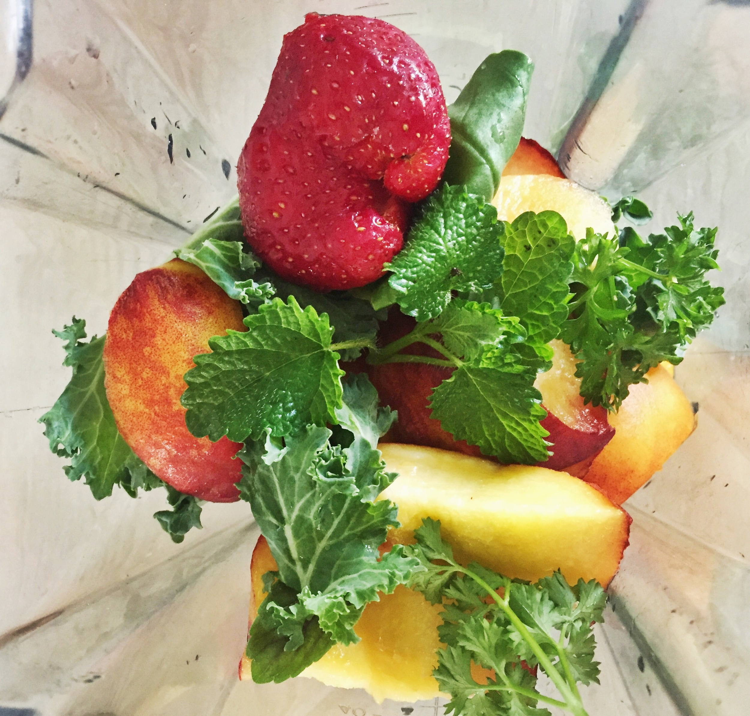 Peaches, kale, strawberries and mint from the local Farmer's Market