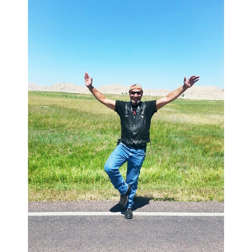 Yoga student Nick, taking a break in Tree pose on his way to South Dakota on his Harley