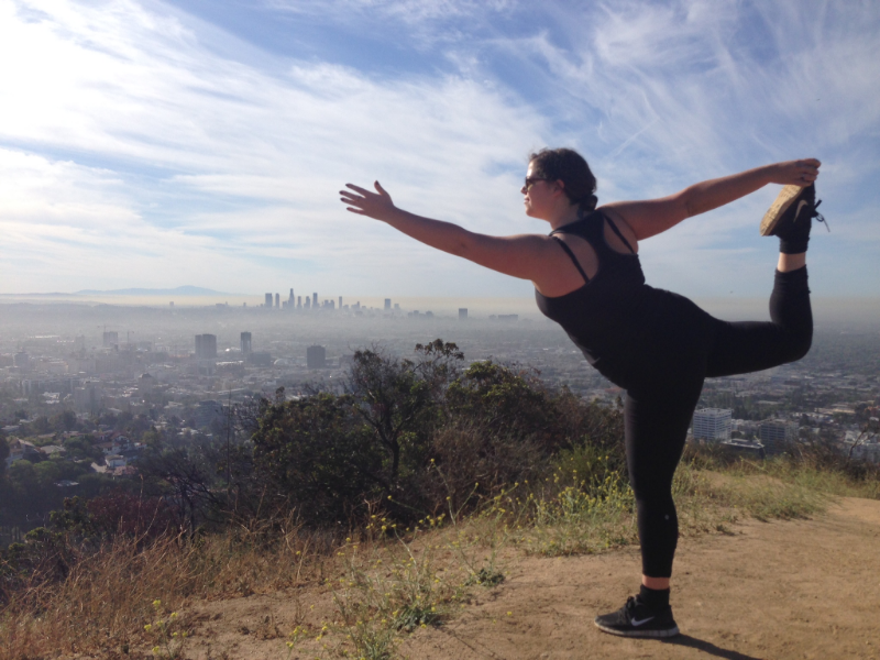 Yoga student Christian in Dancer pose in LA