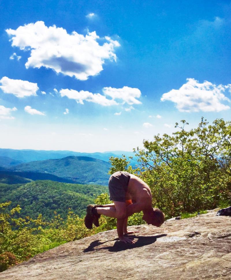 Yoga student Scott in Crow pose on Blood Mountain, GA