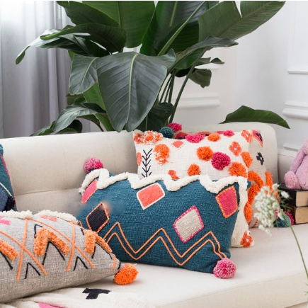 2. Multi-colored Pillows & Throws -