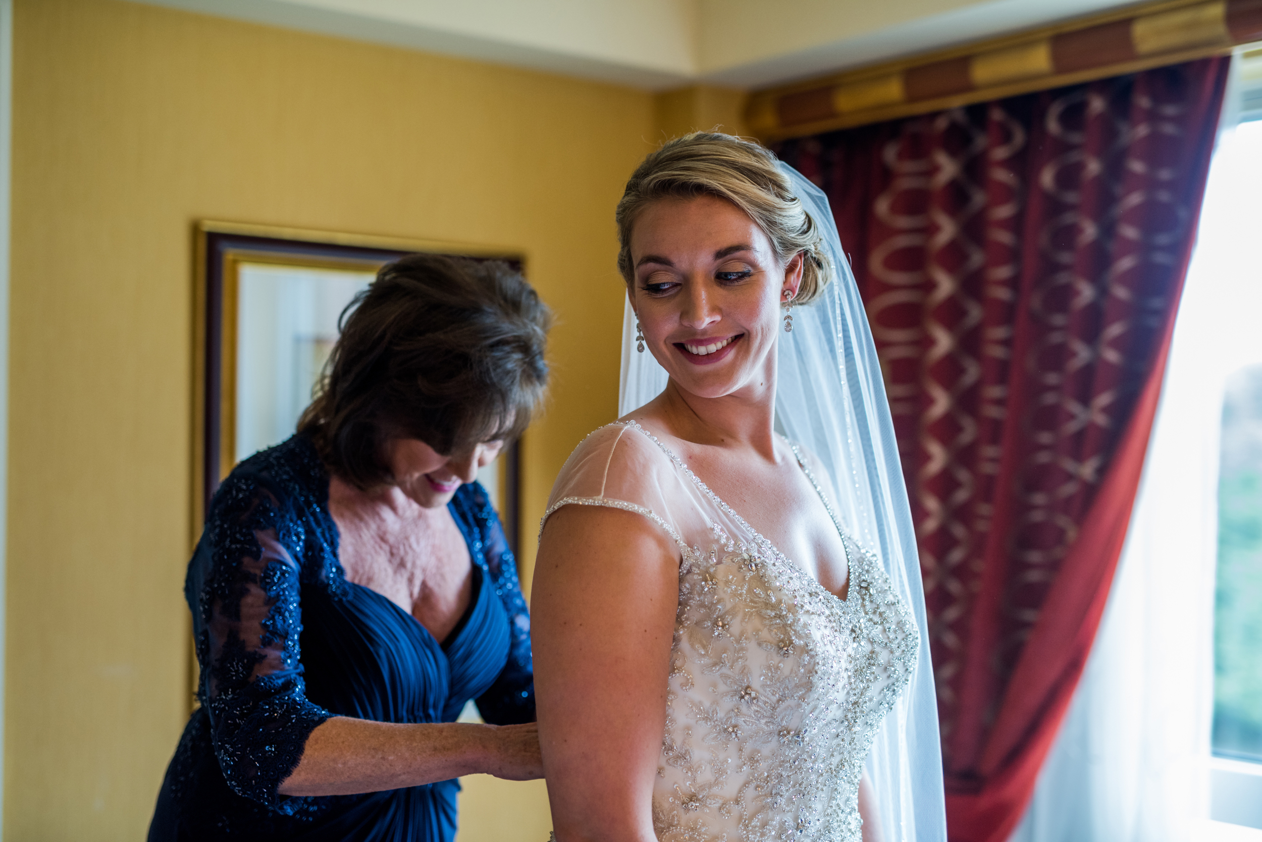 mother helping dress wedding.jpg