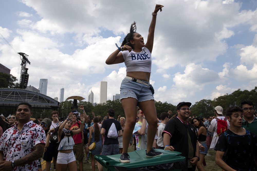 Nancy Toledo, 23, dances atop a trash can during London on da Track's set at Lollapalooza Thursday, August 2, 2018, at Grant Park in Chicago. (Erin Hooley/Chicago Tribune)