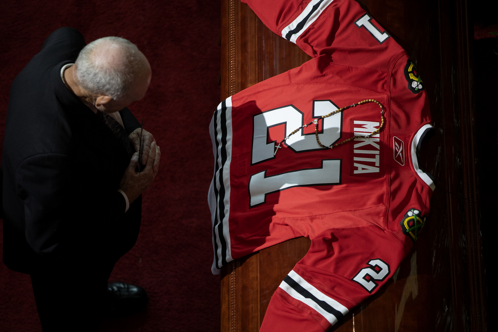 A jersey and rosary cover the casket of Stan Mikita during a public visitation for the Chicago Blackhawks legend, who died August 7 at the age of 78, Sunday, Aug. 12, 2018, in the atrium of the United Center in Chicago. Mikita played 21 seasons for the Blackhawks, winning the Stanley Cup in 1961 and, individually, the Hart, Art Ross and Lady Byng trophies numerous years. (Erin Hooley/Chicago Tribune)