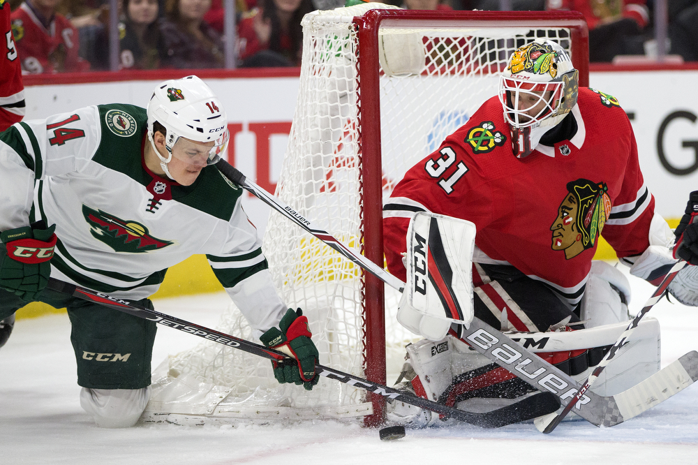 Chicago Blackhawks goaltender Anton Forsberg (31) makes a save against Minnesota Wild center Joel Eriksson Ek (14) during the second period of the Chicago Blackhawks versus Minnesota Wild Wednesday, Jan. 10, 2018, at the United Center in Chicago. (Erin Hooley/Chicago Tribune)