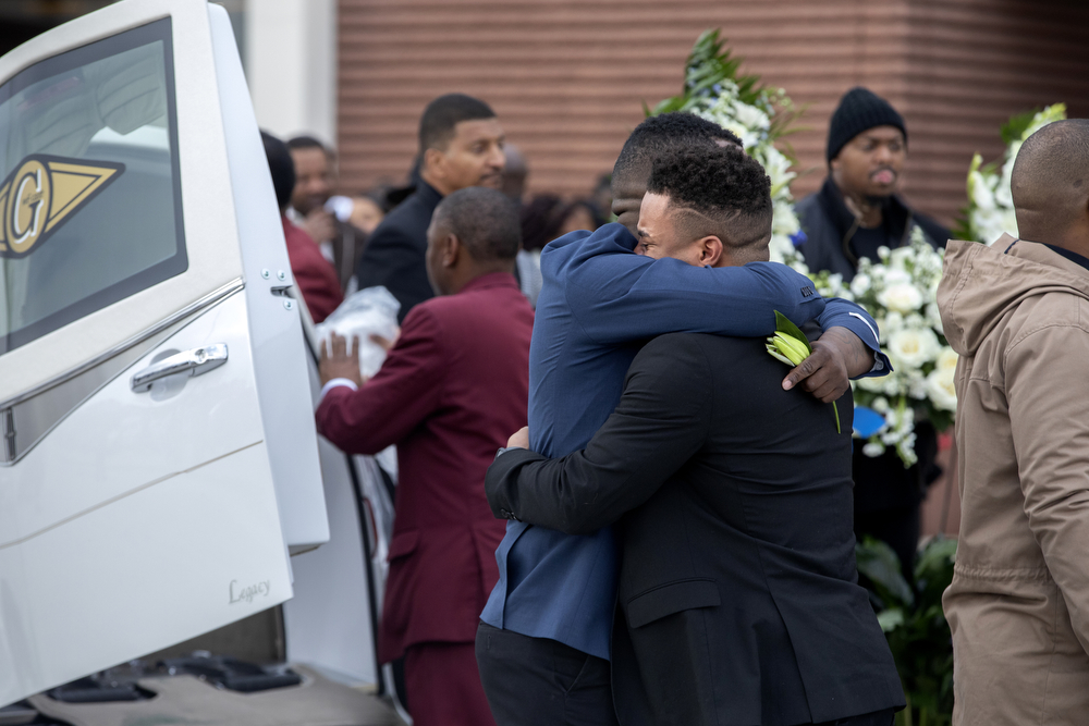 Friends and family comfort each other after the funeral for 26-year-old Jemel Roberson Saturday, Nov. 24, 2018, at House of Hope Church in Chicago. Roberson, an armed security guard at Manny's Blue Room Lounge in Robbins, was trying to subdue a suspect in a bar shooting early November 11 when he was shot and killed by a Midlothian police officer who responded to the call. (Erin Hooley/Chicago Tribune)