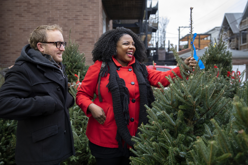 Kish and Mike Carothers pick out a Christmas tree at Ivy's Christmas Trees Sunday, Nov. 25, 2018, in the Lake View neighborhood of Chicago. Ivy's, in its 29th year of business, sells only North Carolina Fraser Firs. (Erin Hooley/Chicago Tribune)