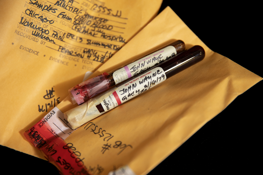 Two vials of the blood of the serial killer John Wayne Gacy are seen in an evidence room Tuesday, Dec. 4, 2018, at the Cook County Warehouse in Chicago. Although Detective Sgt. Jason Moran of the Cook County Sheriff's Office and Sheriff Tom Dart do not believe there are any undiscovered victims of Gacy's, they had his DNA profiled from this blood and entered into modern databases just in case. (Erin Hooley/Chicago Tribune)