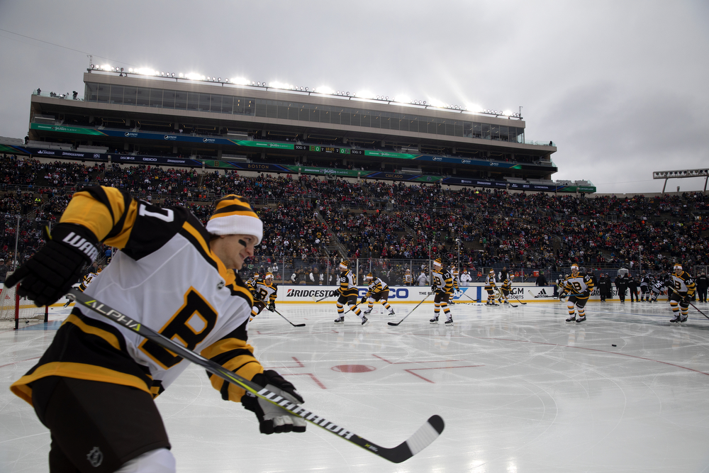 The Boston Bruins warms up before the Winter Classic outdoor hockey game between the Chicago Blackhawks and Boston Bruins Tuesday, Jan. 1, 2019, at Notre Dame Stadium in South Bend, Ind. (Erin Hooley/Chicago Tribune)